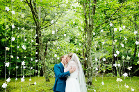 Catskill Mountain Wedding at Full Moon Resort- kissing under the trees