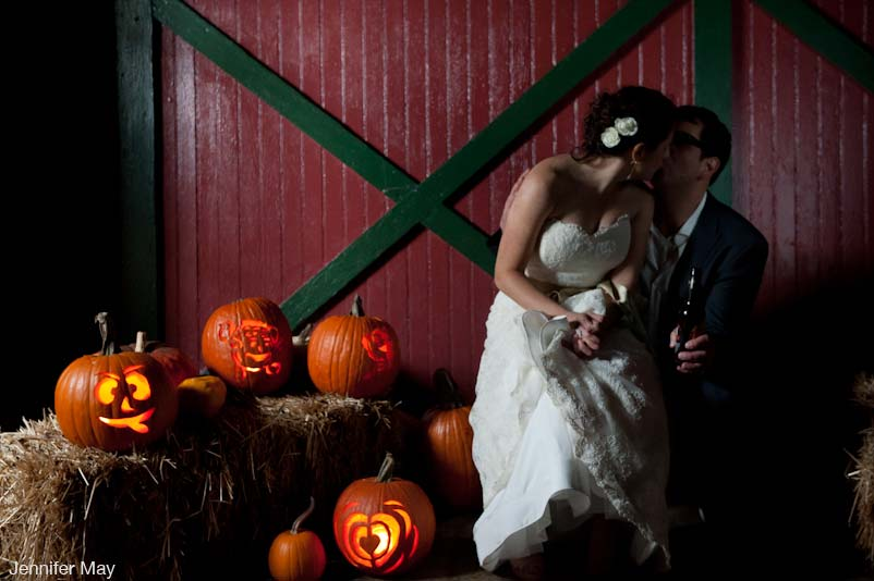 pumpkins & kiss in front of barn- Full Moon resort