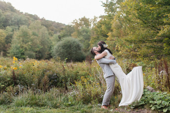 Kissing couple amongst wildflowers frolic