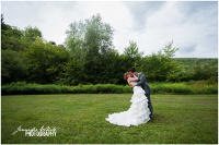 Wedding couple kiss on lawn
