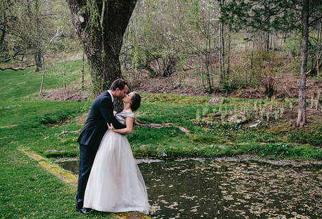 Catskill Mountain Wedding at Full Moon Resort- kissing near the barn pond