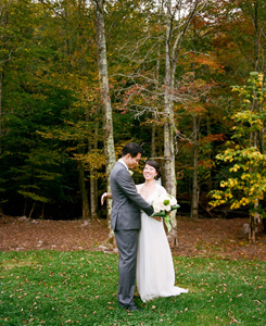 wedding couple with Autumn trees