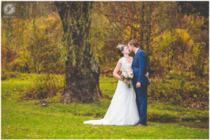 Autumn Wedding kissing near Spruce Barn Pond