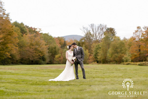 September Wedding- portrait in the meadow with Eagle Mountain view and autumn trees