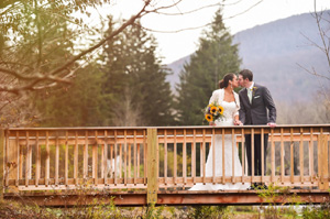 Autumn Wedding kissing on Panther Mountain Bridge