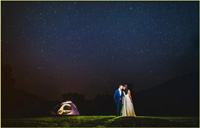 Wedding couple camping under the starry night