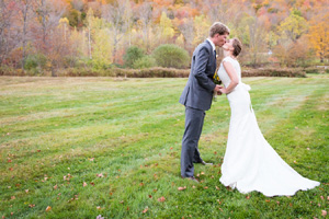 Autumn Wedding kissing in the meadow