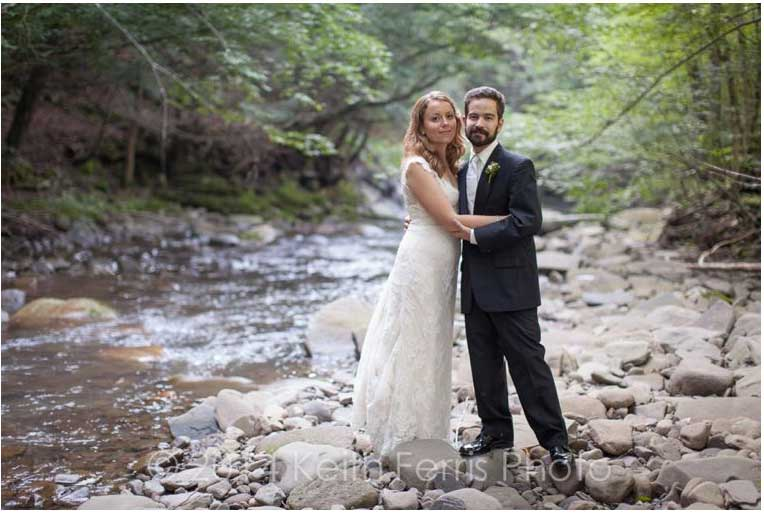 Autumn Wedding couple portrait in Upper Esopus Creek adjacent to Full Moon Resort property