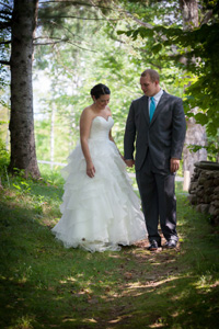 August wedding- couple walking along stone wall path