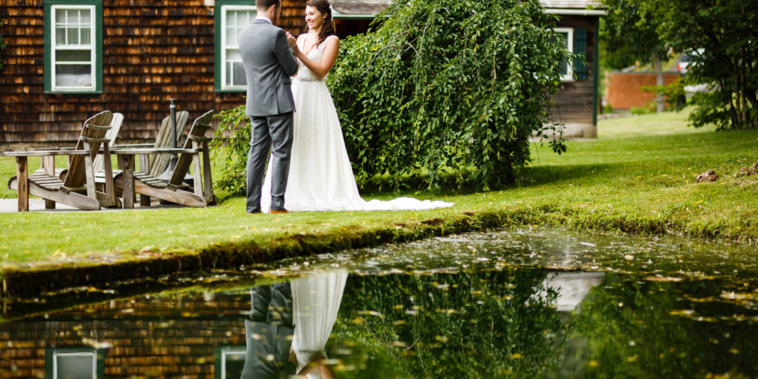 Wedding couple reflection in small pond