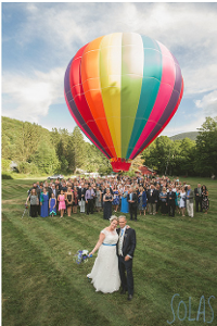 Wedding couple And group with colorful hot air balloon on Full Moon resort field