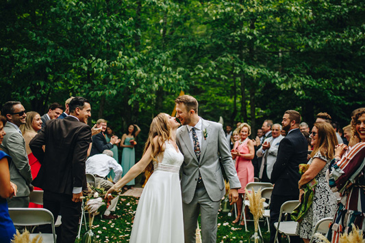 Joyful kiss after beautiful ceremony