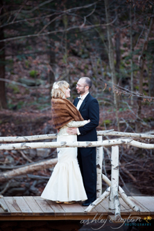 Late Fall Wedding at Full Moon Resort- standing on a handhewn bridge