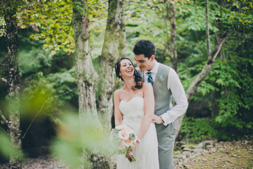 Fall wedding- laughter and frolicking in the woods