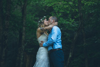 Wedding couple kissing in the woods