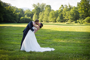 Couples loving embrace in the meadow