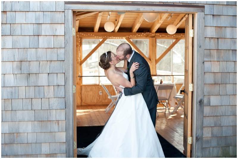 Winter Wedding at Full Moon Resort- Kiss in front of the barn