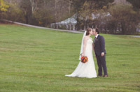 October Wedding- kiss on lawn in front of big top