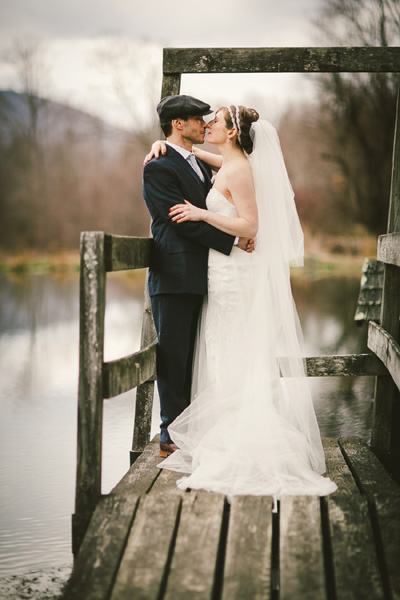 Early Spring Wedding at Full Moon Resort- Kissing by the pond