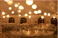 under the tent lights & table-Catskill Mountain Wedding at Full Moon Resort
