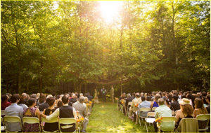 September wedding ceremony set next to the creek