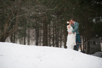 kiss in the snow-Catskill Mountain Wedding at Full Moon Resort